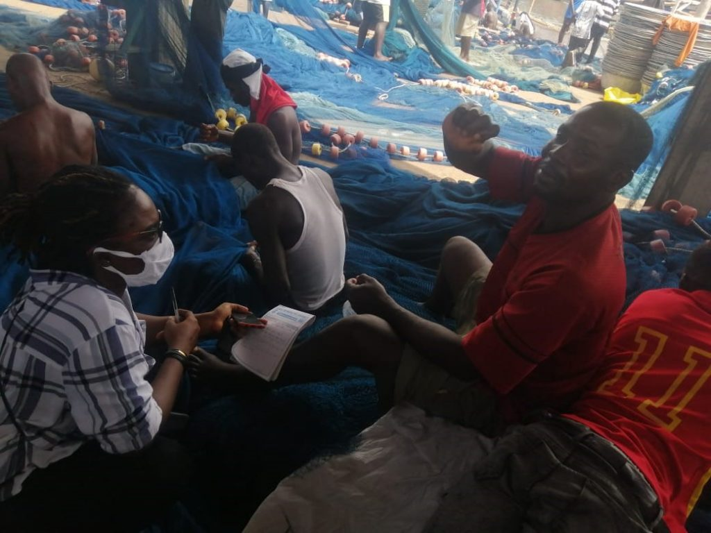 An interaction with Mr. John Botse and other fishers as they mend their nets/ Credit: Eunice Osei-Yeboah